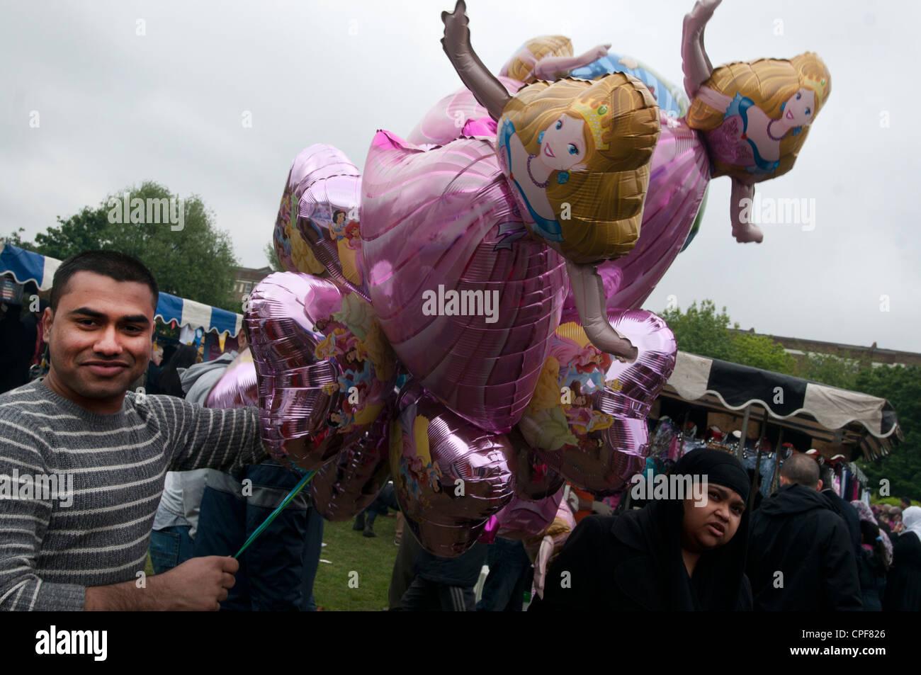 Boishakhi Mela, celebration for Bangladesh New Year. Bangladeshi man selling helium Cinderella balloons - Stock Image