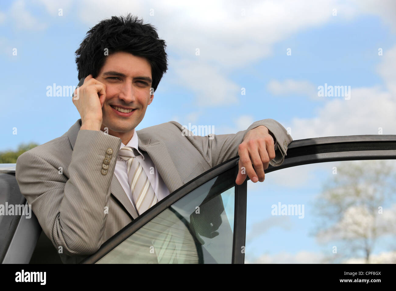 Man using mobile in his car - Stock Image