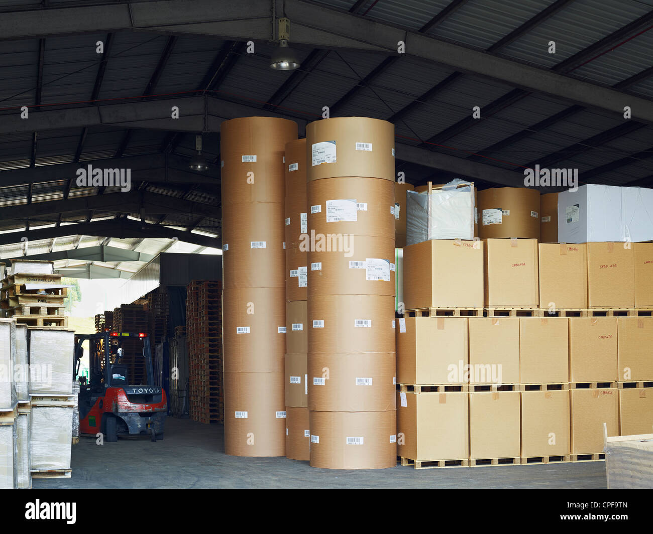 Stacked palettes and cardboard containers at a printing press in Malaysia. April 28, 2011. - Stock Image