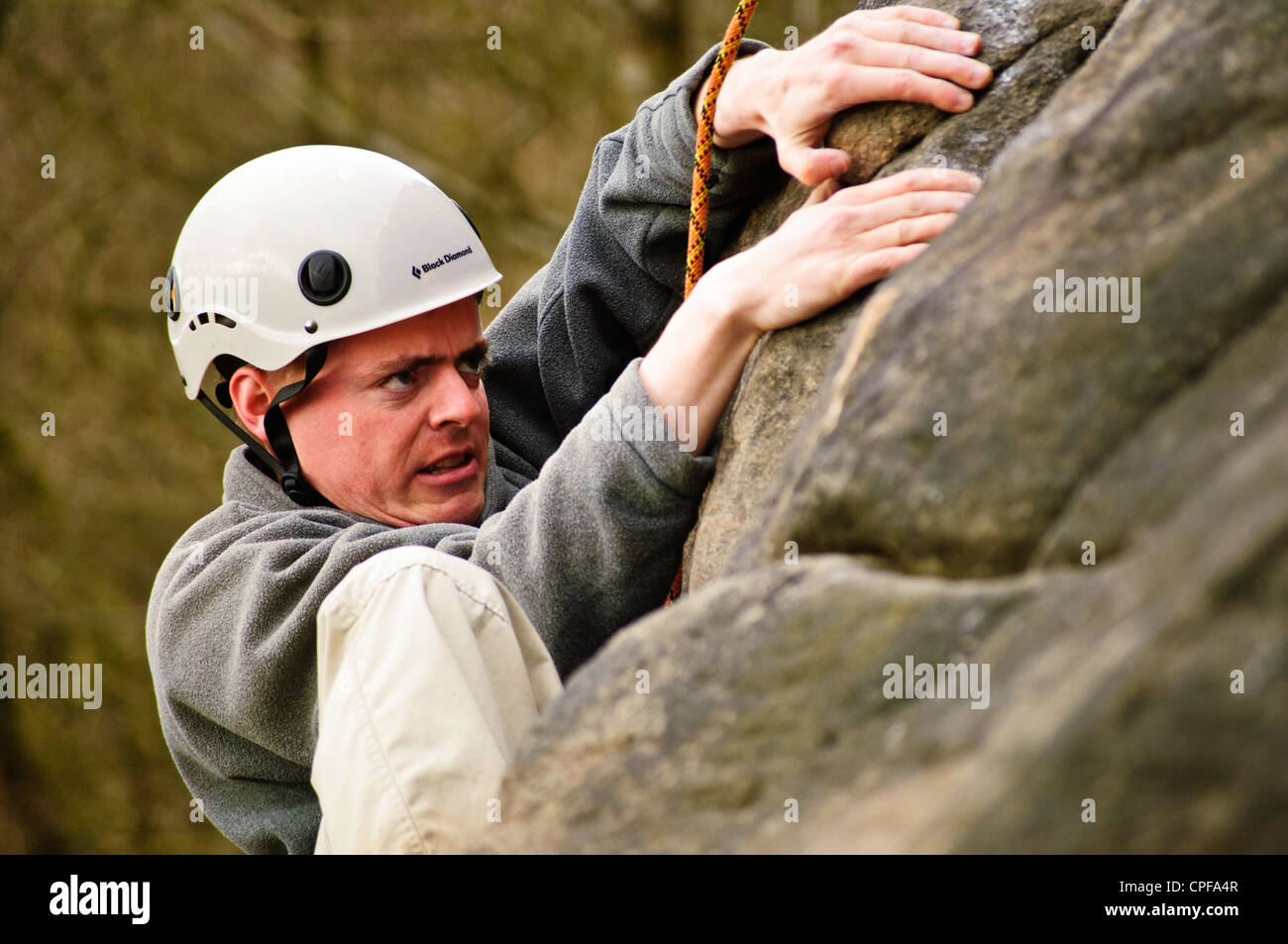 Climber on Tody's Wall, Froggatt Edge, Peak District graded HVS 5a - Stock Image