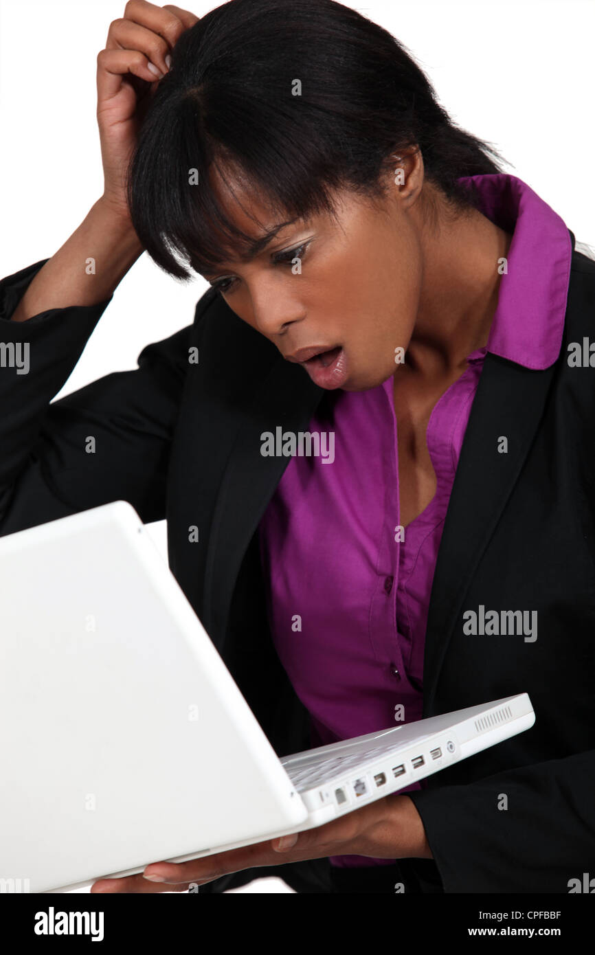 A dubious African American businesswoman. - Stock Image