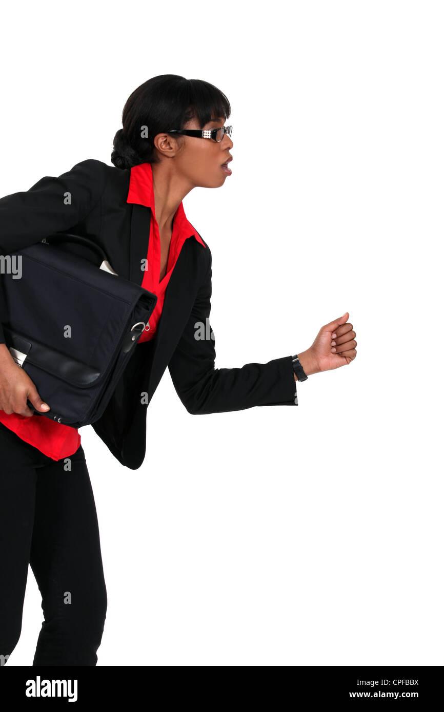 Businesswoman in running - Stock Image