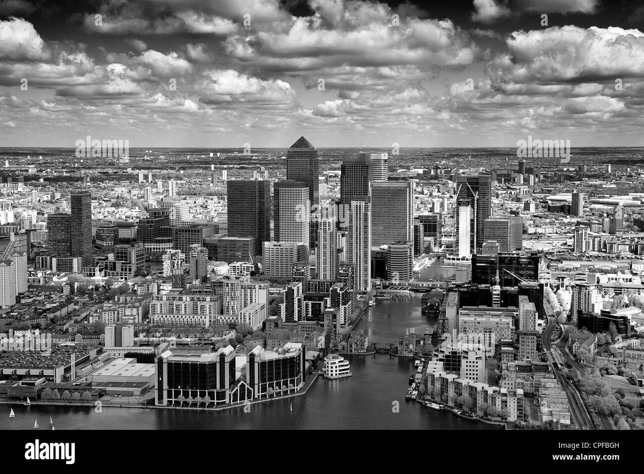 Aerial shot of the isle of dogs, London, looking at canary wharf in the distance - Stock Image