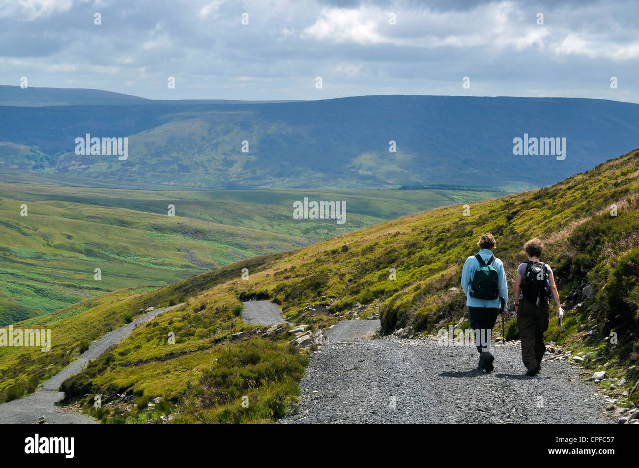 Walkers on Ward's Stone, in the Forest of Bowland AONB - Stock Image