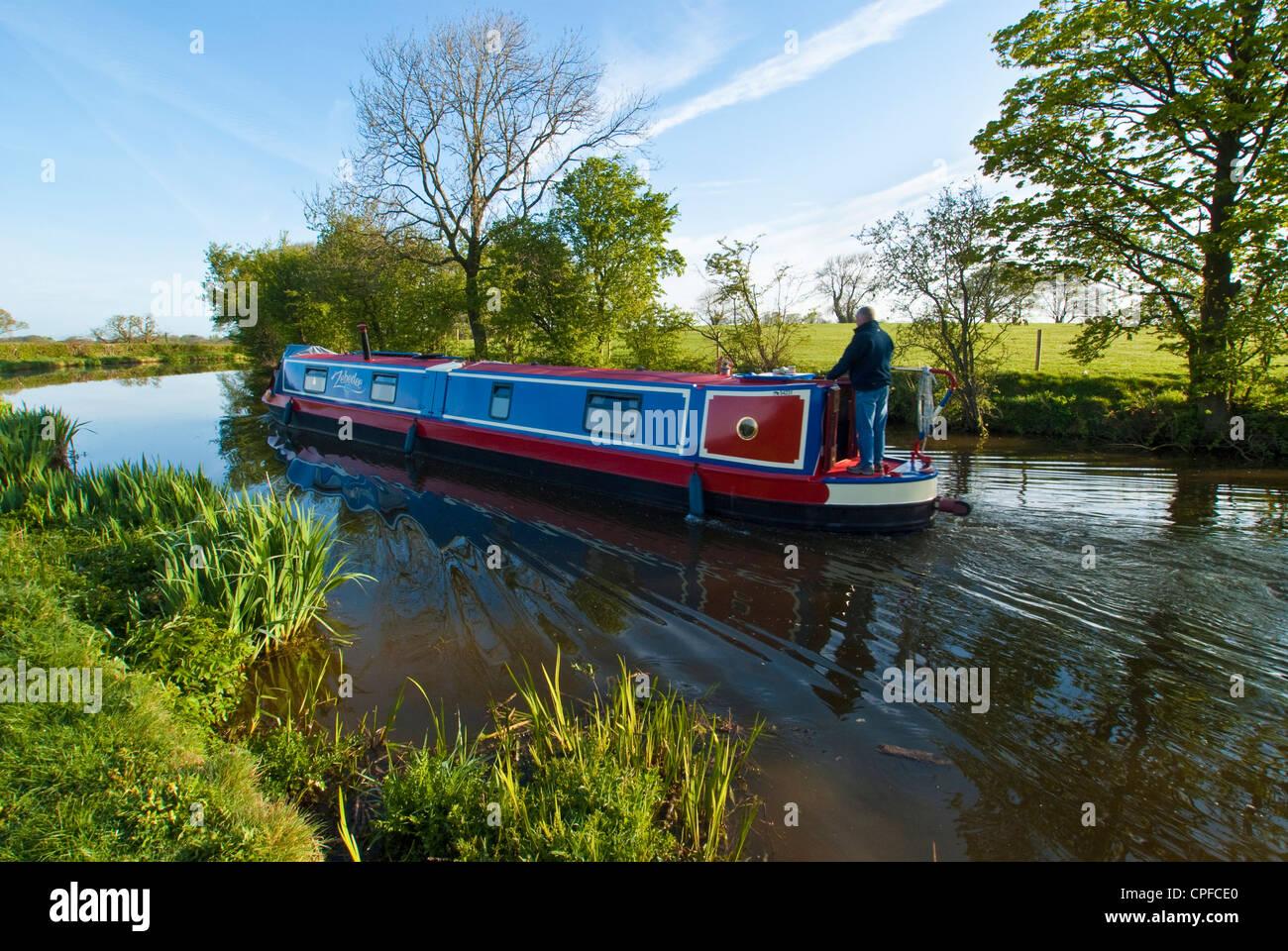 Narrowboat on the Lancaster Canal near Garstang Lancashire England - Stock Image