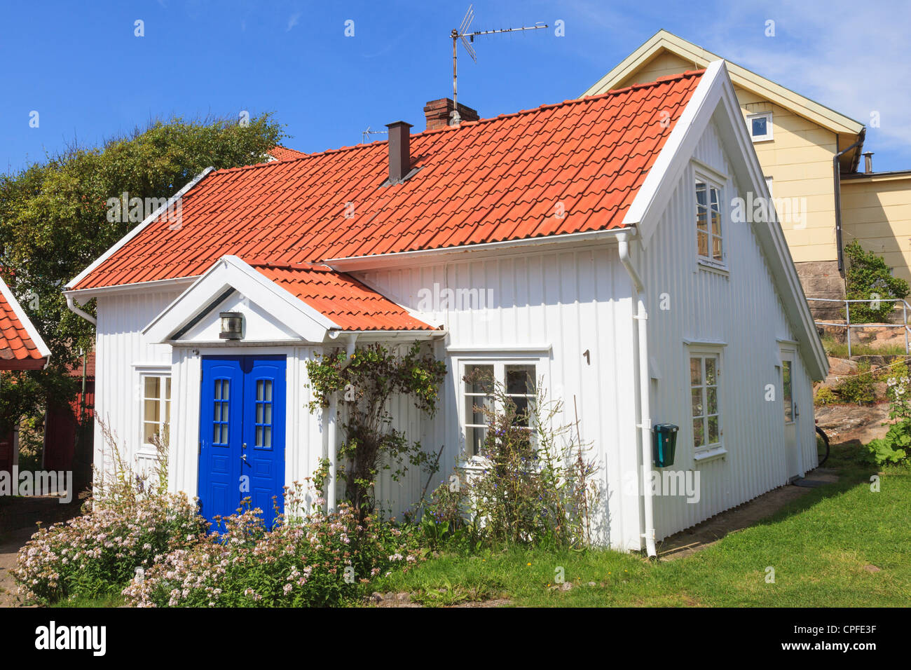 Small old white cottage - Stock Image