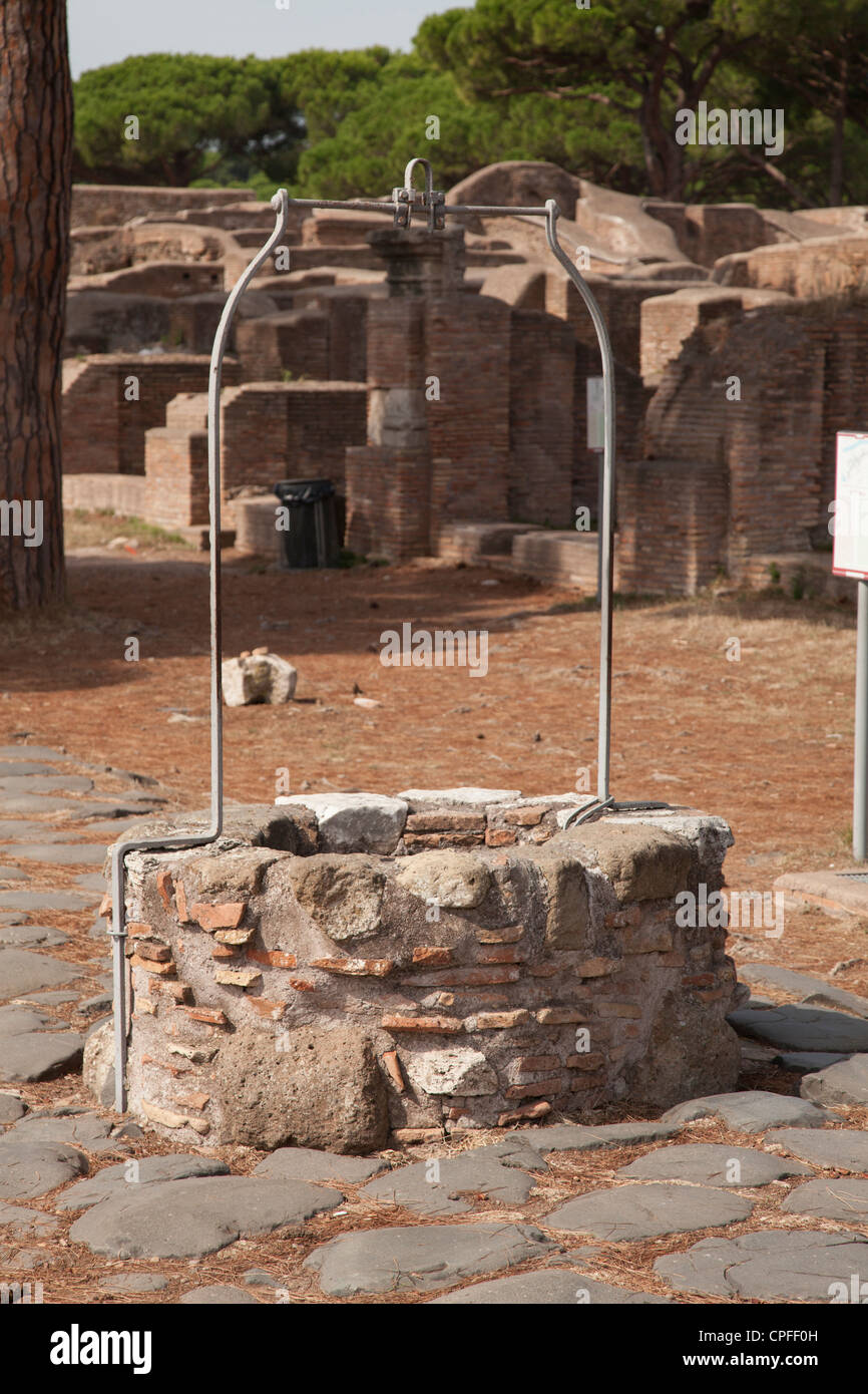 Well on the Decumanus at The ancient roman port town ruin of Ostia near Rome - Stock Image
