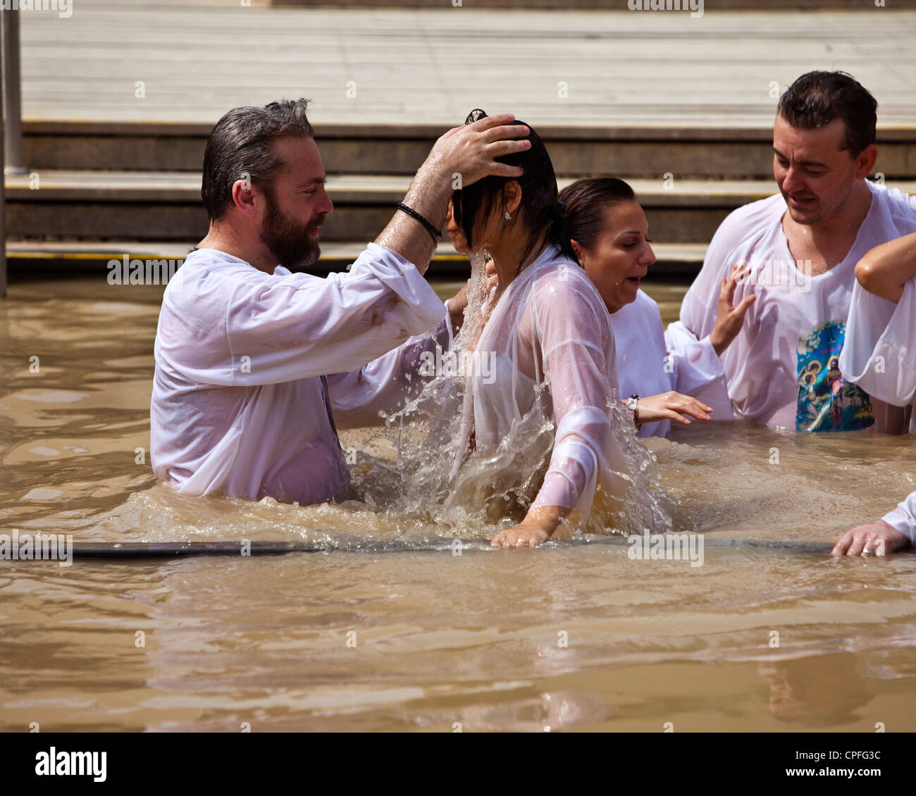 Russian Orthodox Christian Baptism, on the Israeli bank of the River Jordan, from Bethany Beyond The Jordan, Western Stock Photo