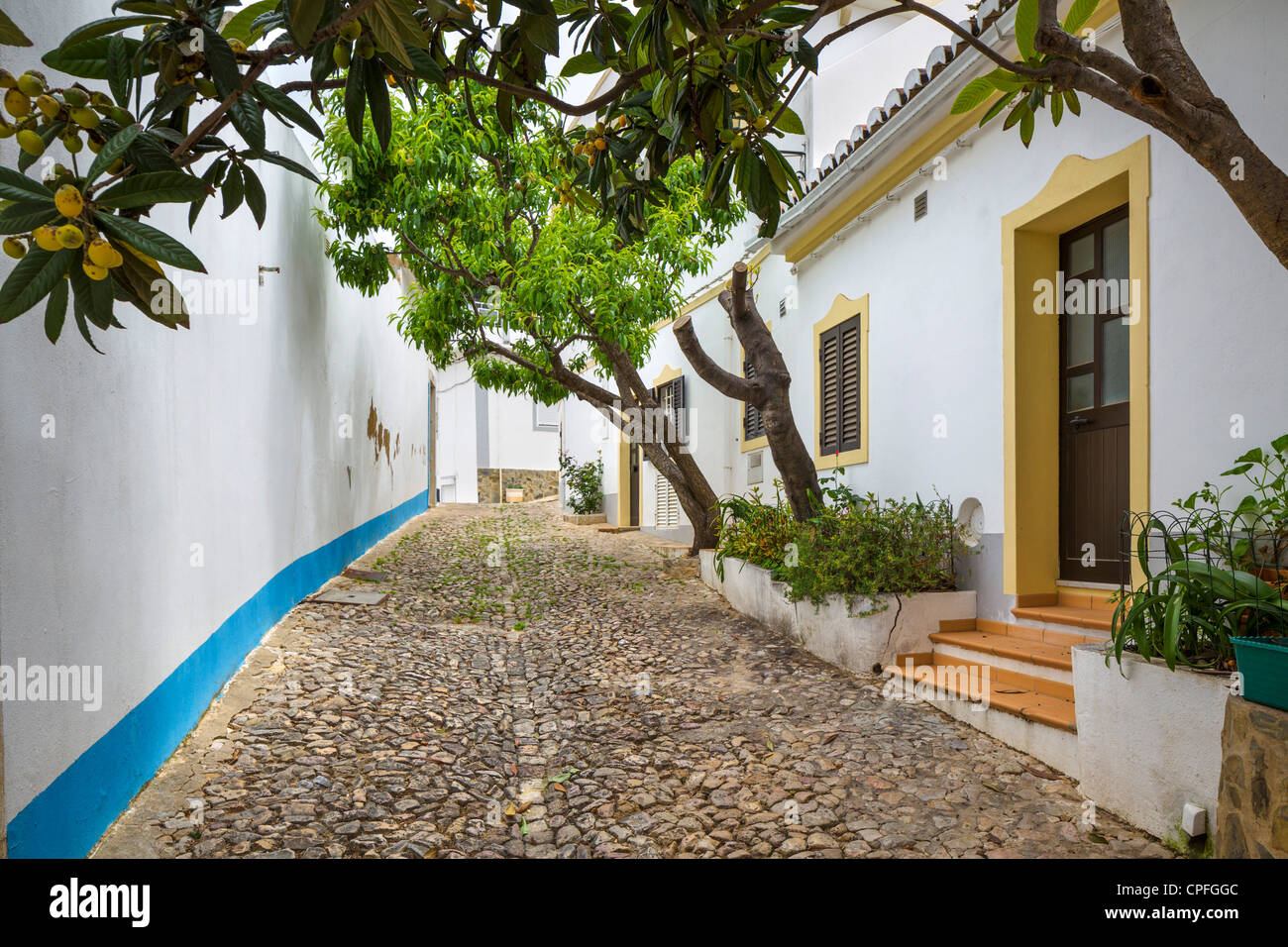 Row of typical houses in the inland town of Loule, Algarve, Portugal - Stock Image