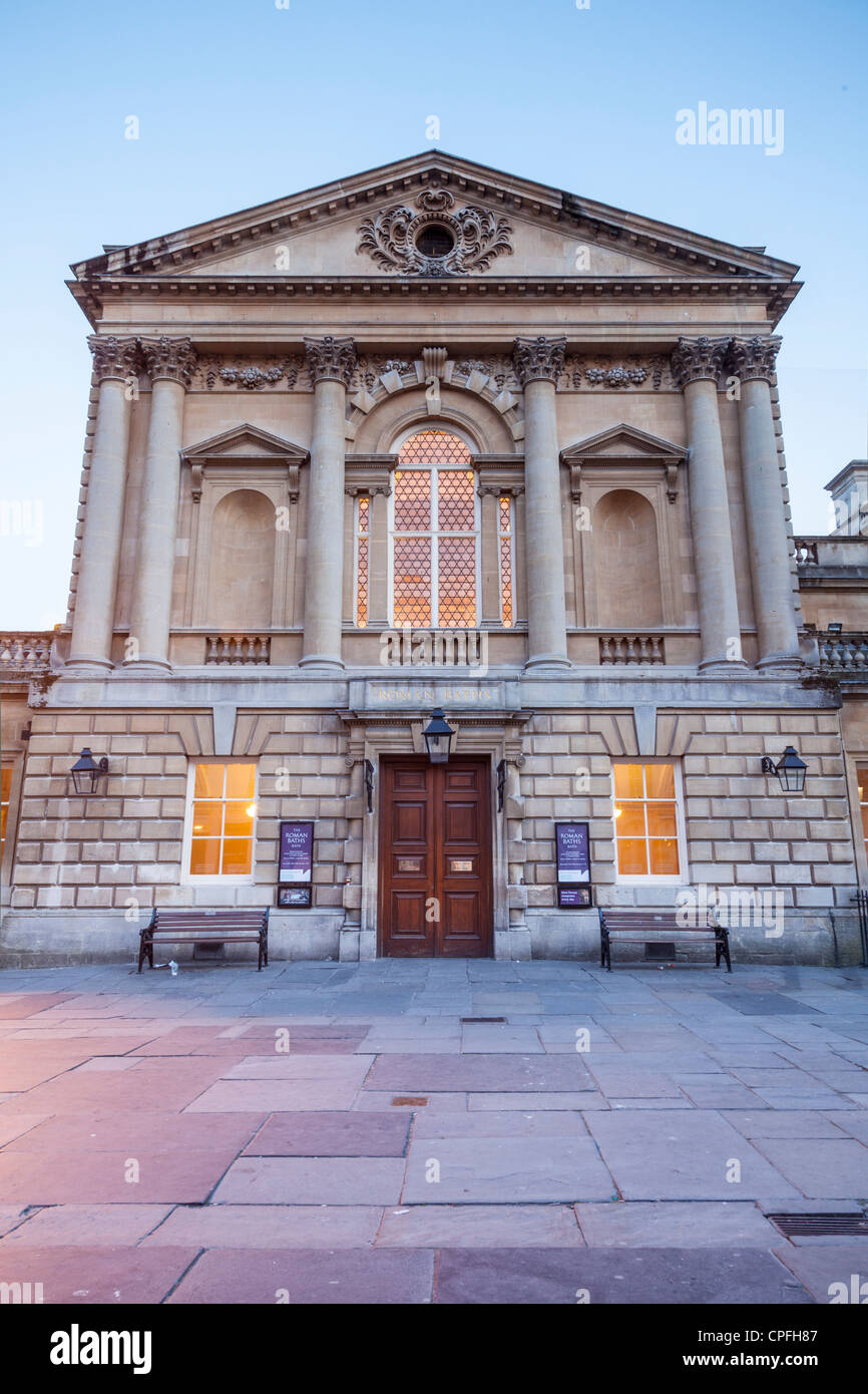 The facade of the Roman Baths in Bath, Somerset, in England photographed at twilight - Stock Image