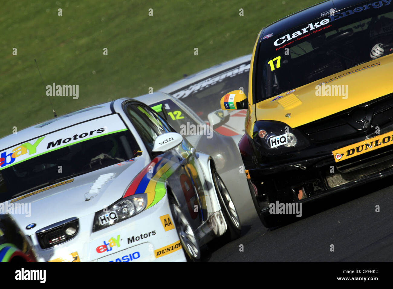 Close up of British Touring Cars in tight racing formation going from McClaren into Clarke Curve at Brands Hatch - Stock Image