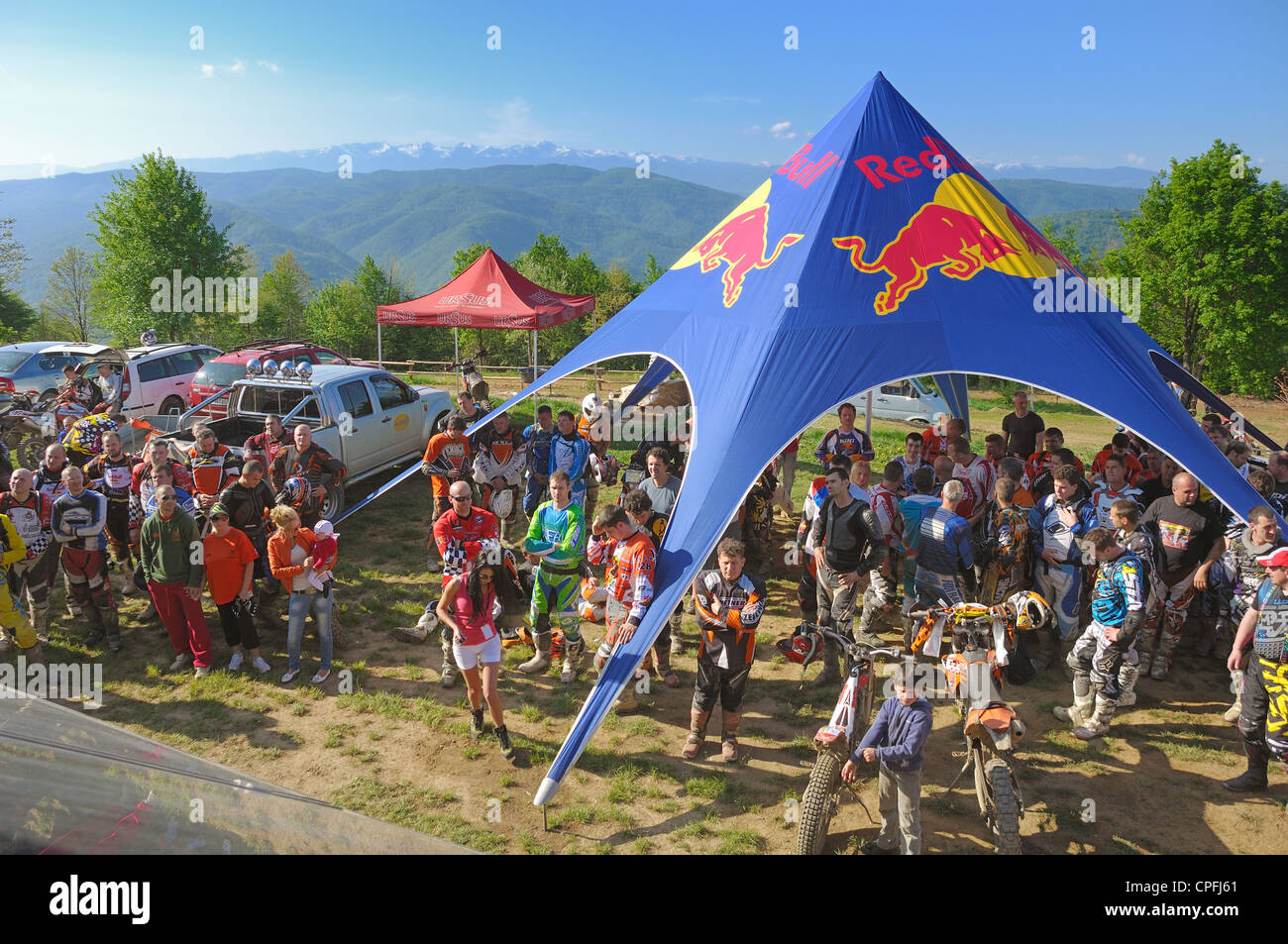 "GHELARI, ROMANIA - MAY 5 2012: group of motocross riders, at briefing hard enduro race ""Enduro Panorama - AIRWAVES Stock Photo"