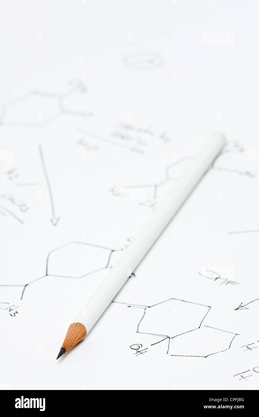Pencil on piece of paper with chemical formula - Stock Image