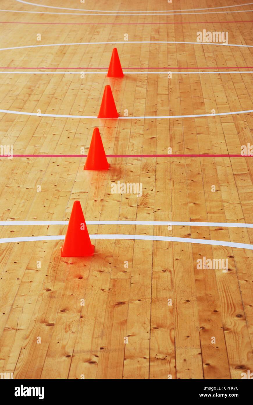 wooden parquet floor in gymnasium; vertical photo - Stock Image