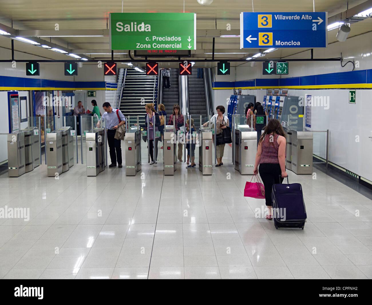 Ticket validation machines at a Madrid metro station - Stock Image