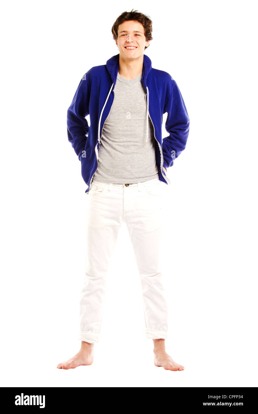 f5077624 Young man dressed in hoodie and barefoot smiling Stock Photo ...