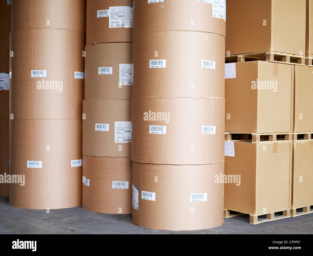 Stacked palettes at cardboard at a printing press in Malaysia. April 28, 2011. - Stock Image