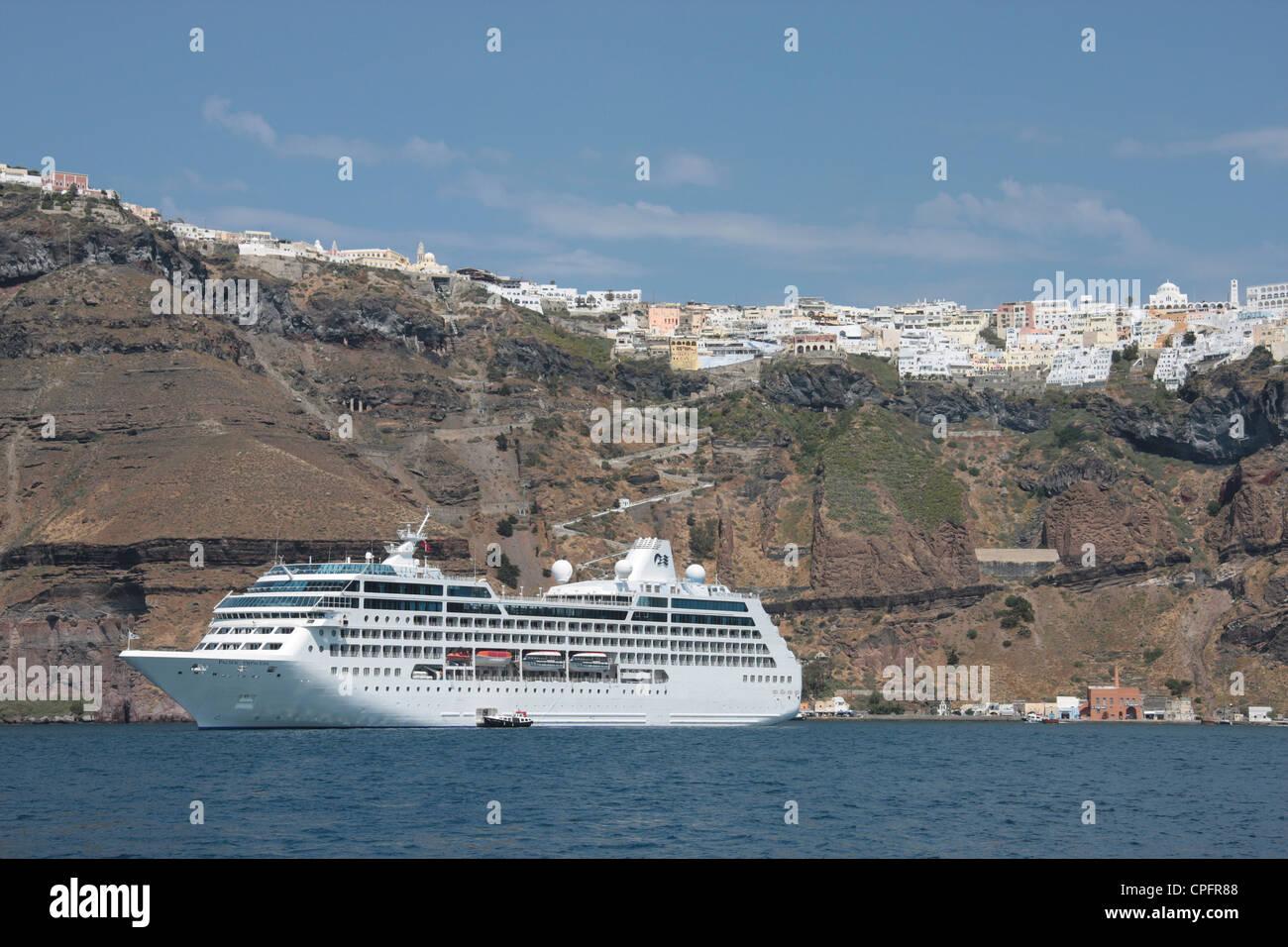 Cruise ship Pacific Princess at anchor in Santorini - Stock Image