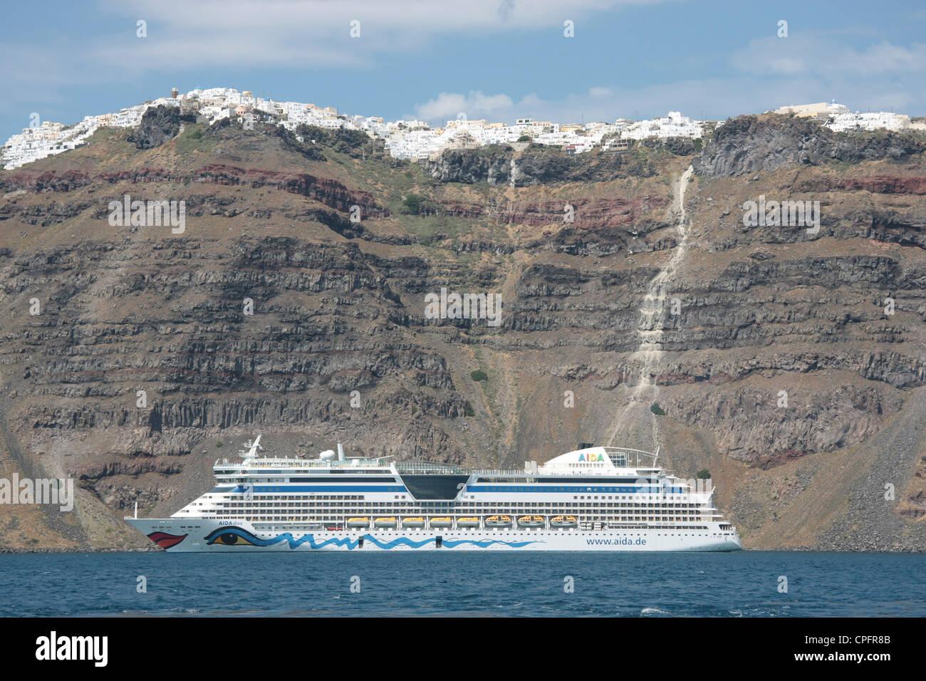 Cruise ship AIDA diva at anchor in Santorini - Stock Image
