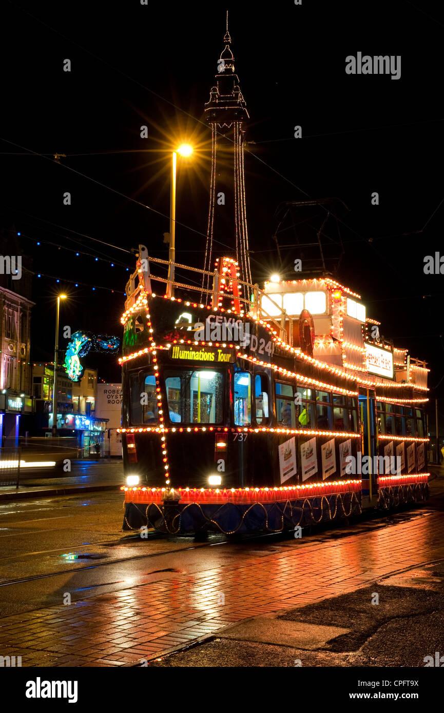 Illuminated tram and Blackpool Tower during the famous Blackpool Illuminations Stock Photo