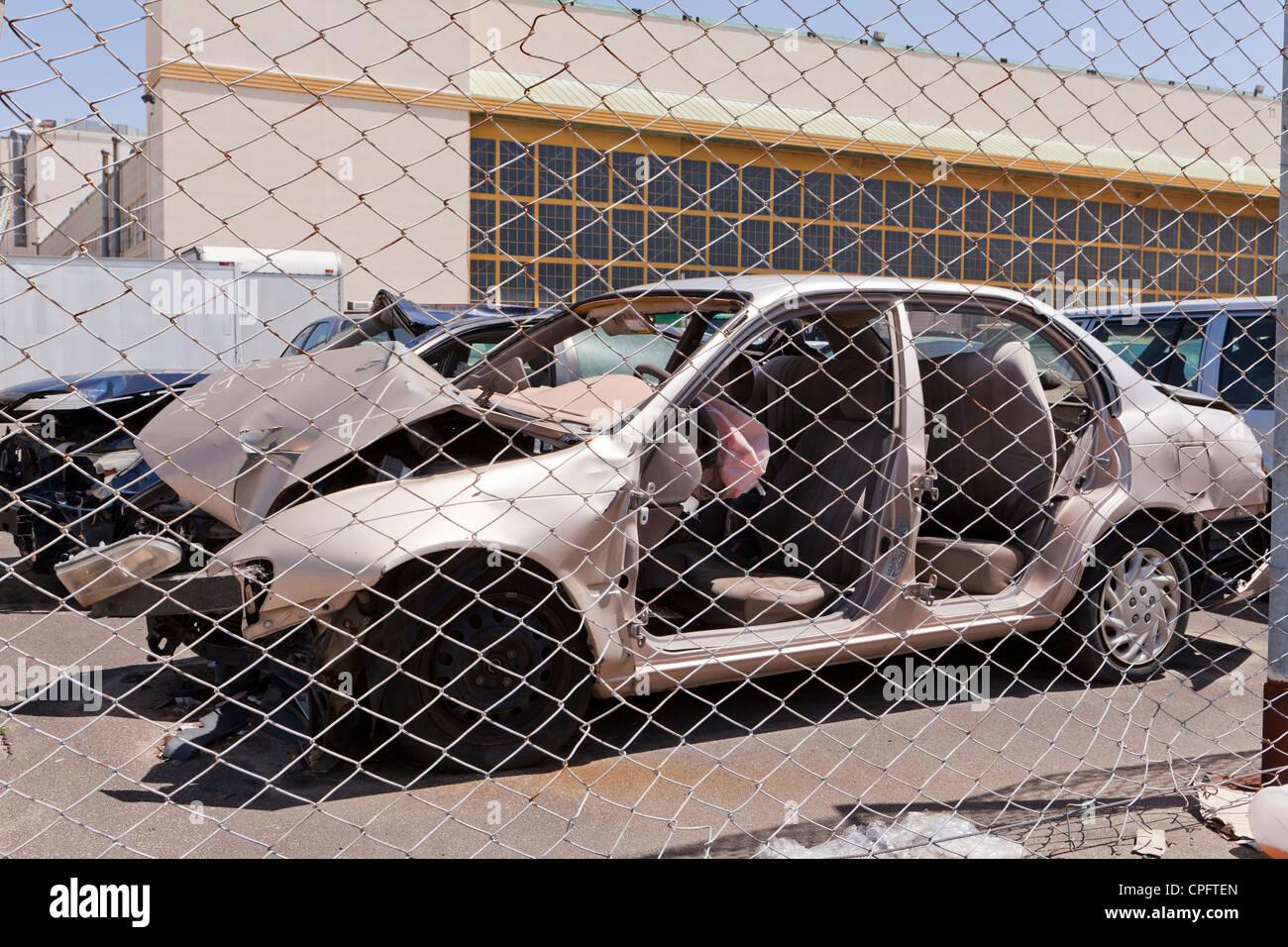A crashed car in junkyard - Stock Image