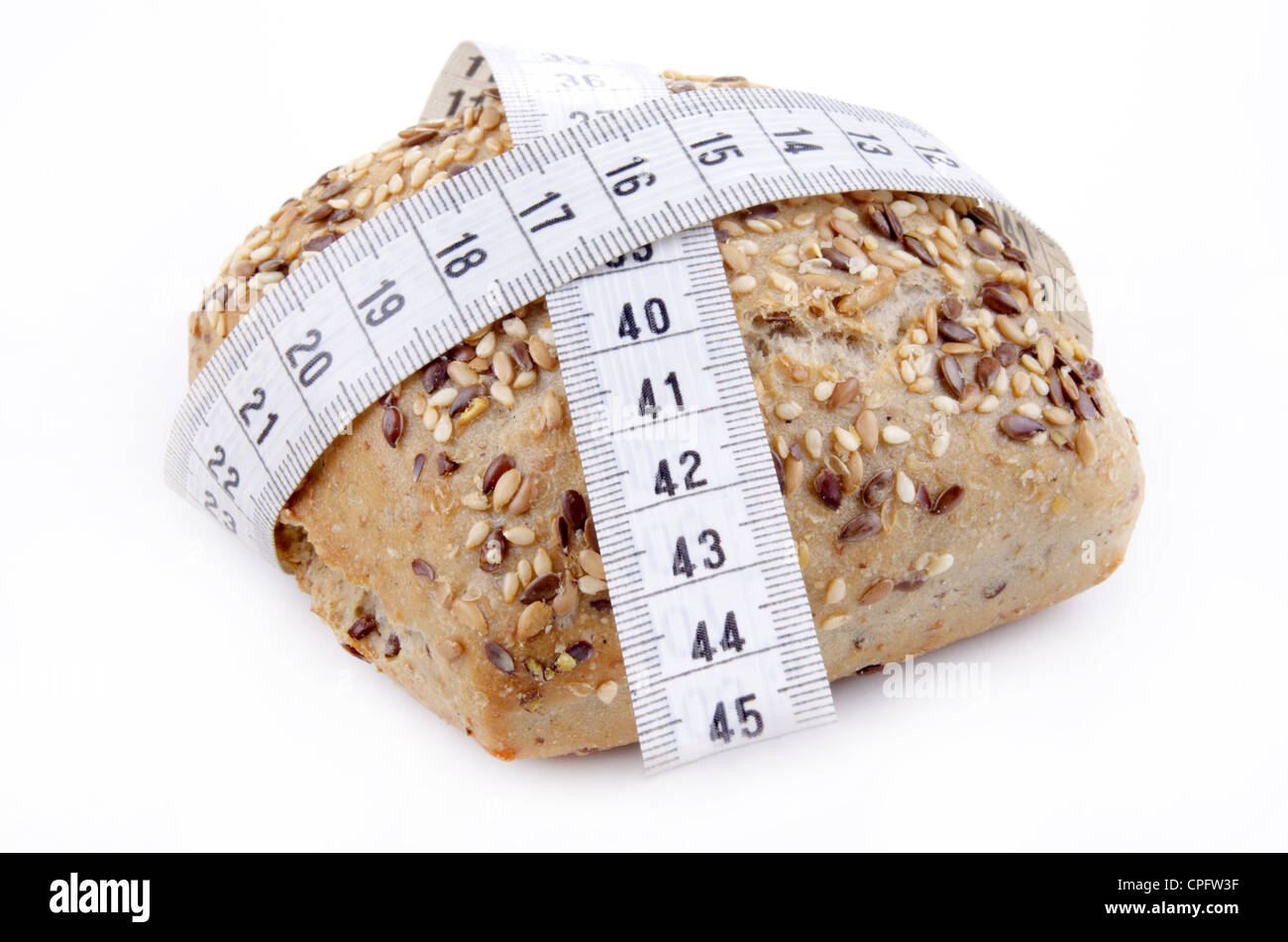 multigrain roll with centimeter measuring tape - Stock Image