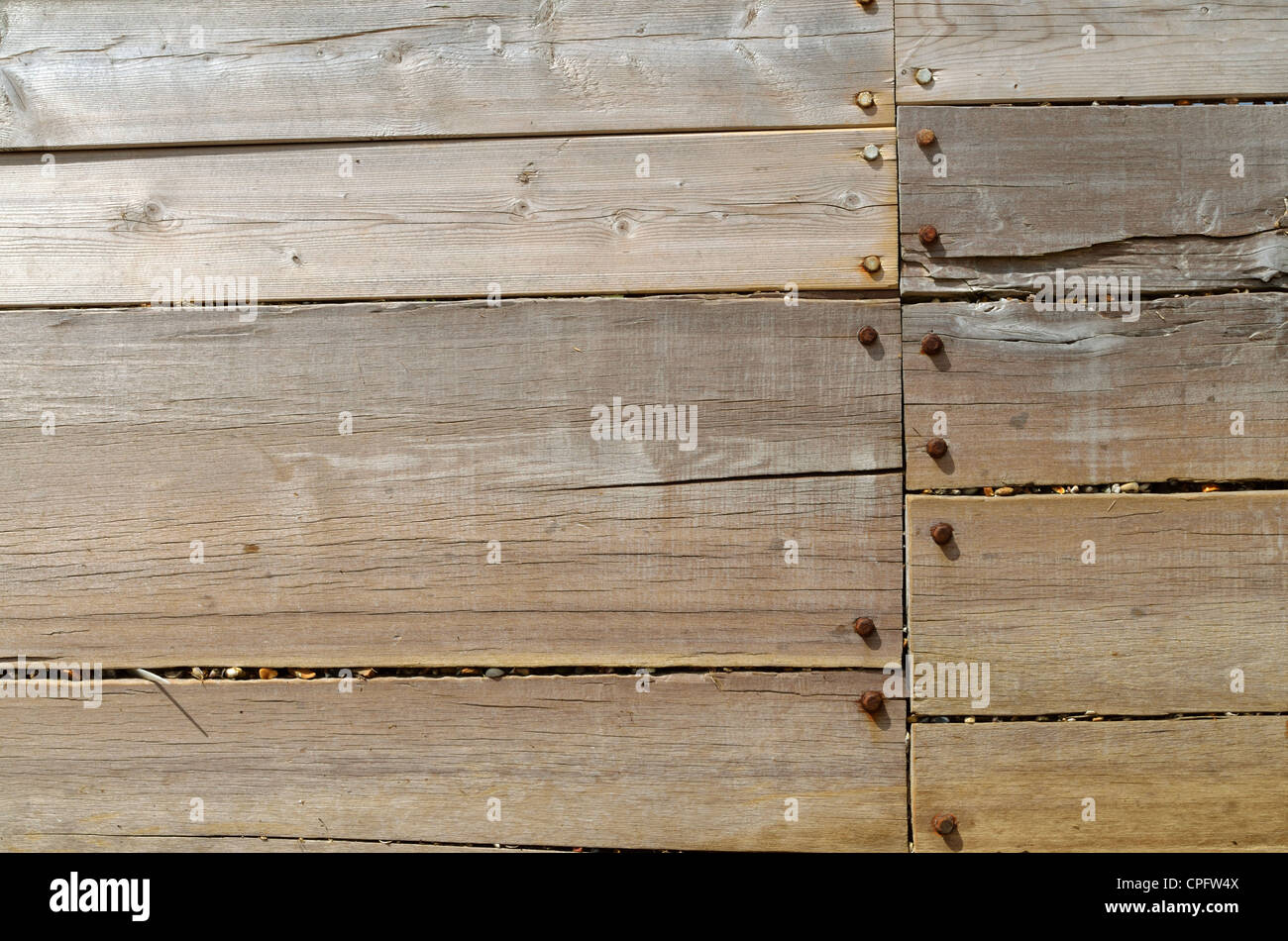 Wooden barrier dividing areas along the shore Stock Photo