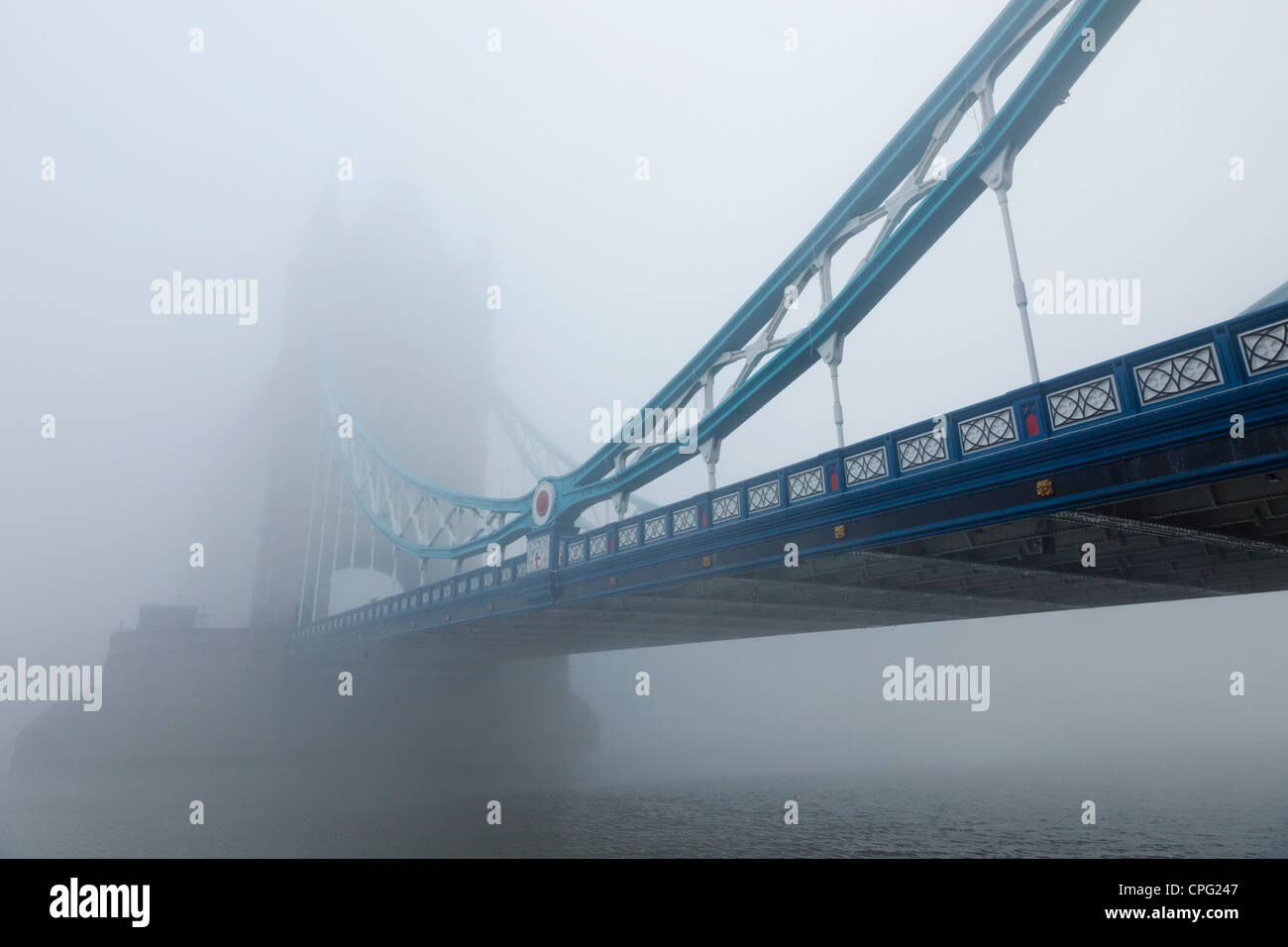 England, London, Southwark, Tower Bridge and River Thames in the Fog - Stock Image