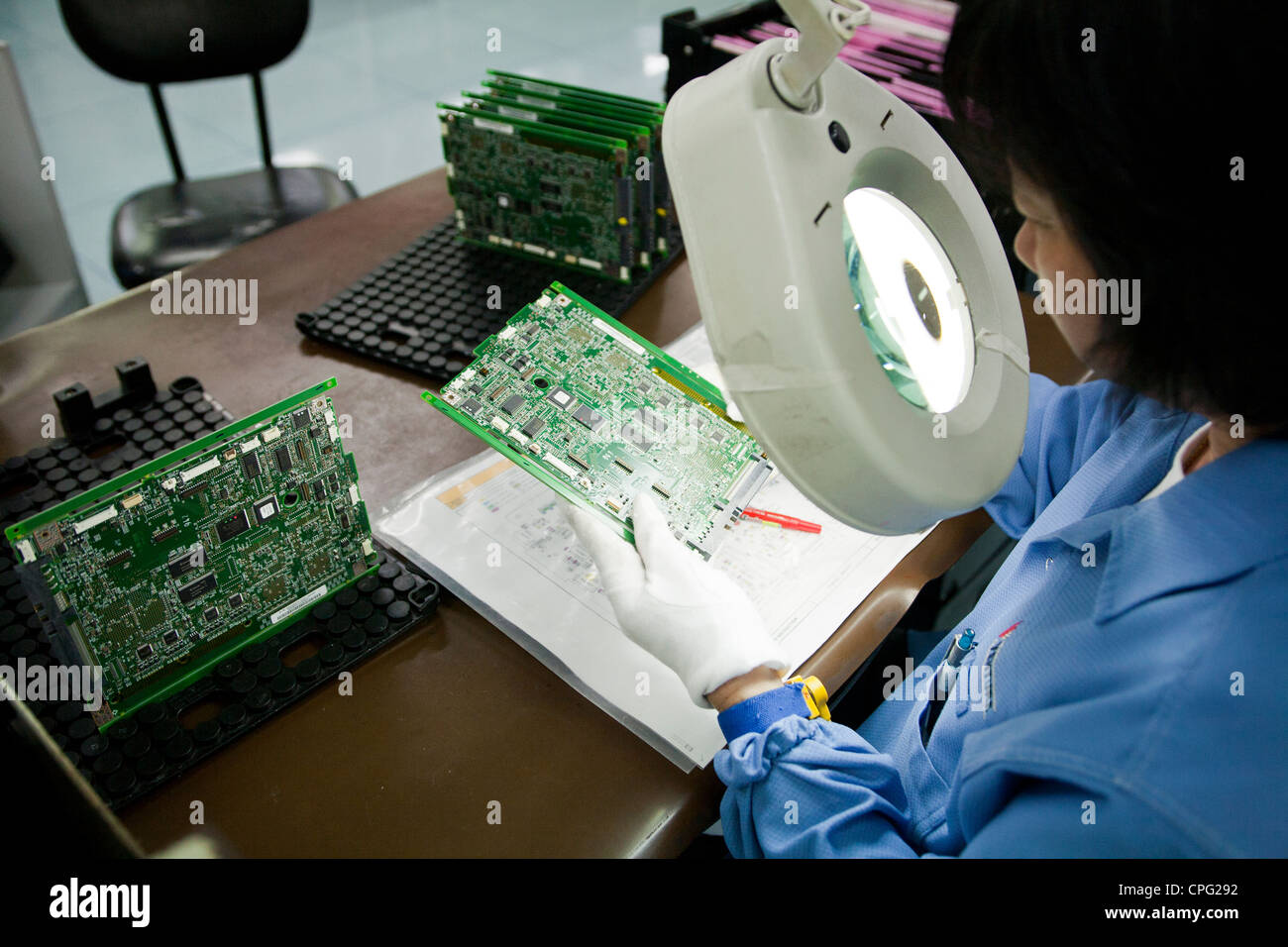 Printed Circuit Board Manufacture Stock Photos Electronic Assembly Jobs A Worker Inspects On The Line At Venture Corp