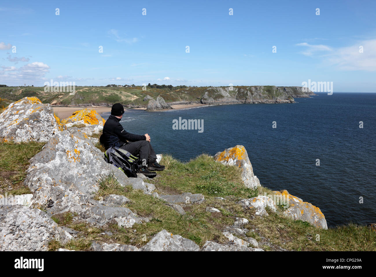 Walker Enjoying the View Over Three Cliffs Bay From Great Torr Penmaen Burrows Gower Wales UK - Stock Image