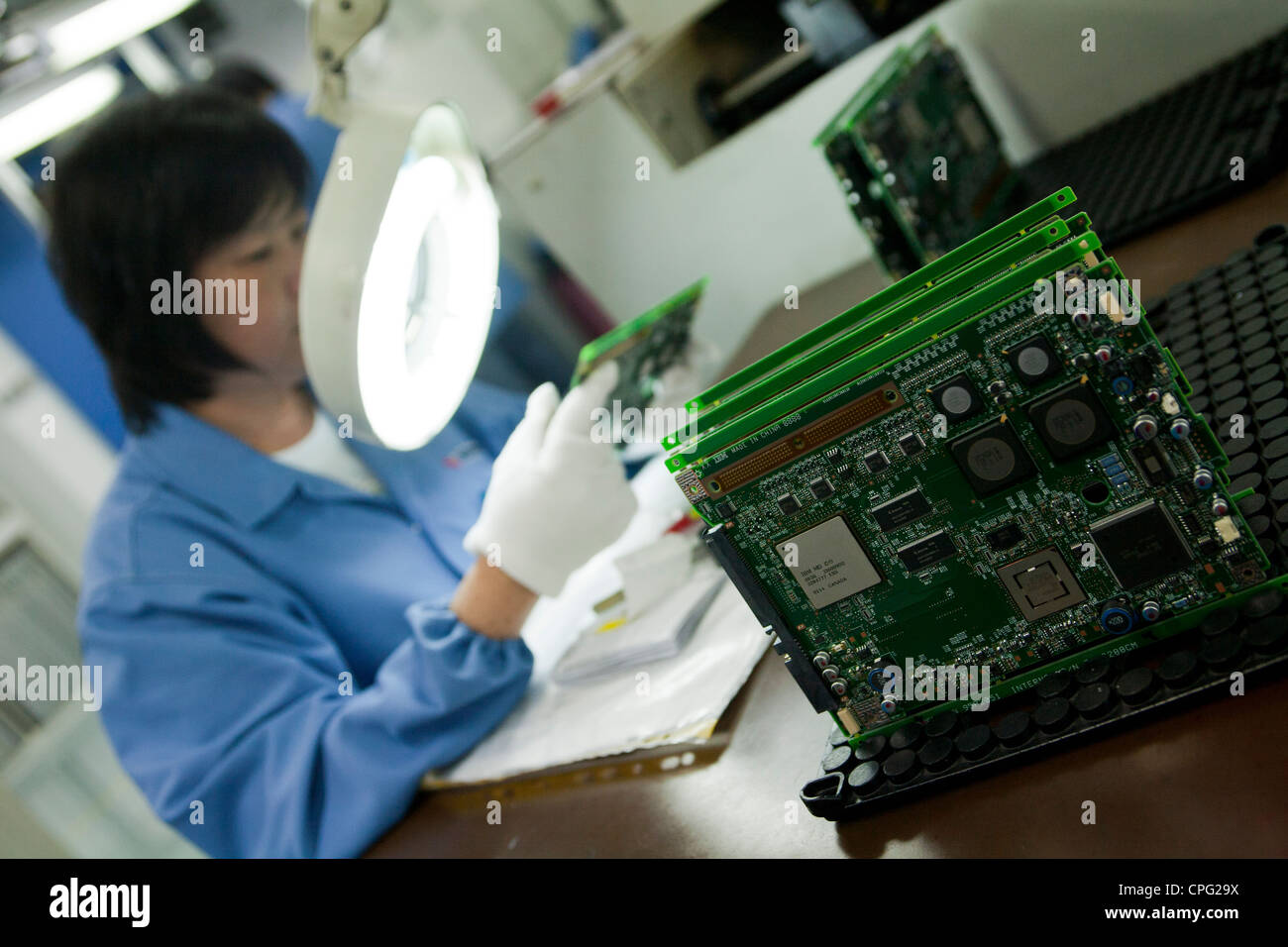A Worker Inspects Printed Circuit Board On The Assembly Line At Low Cost Pcb Fabrication China Venture Corp Factory In Singapore