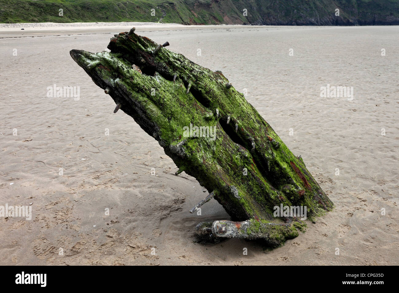 The Remains of the Norwegian Ship The Helvetia Which was Wrecked on Rhossili Beach in 1887 Gower Wales UK - Stock Image