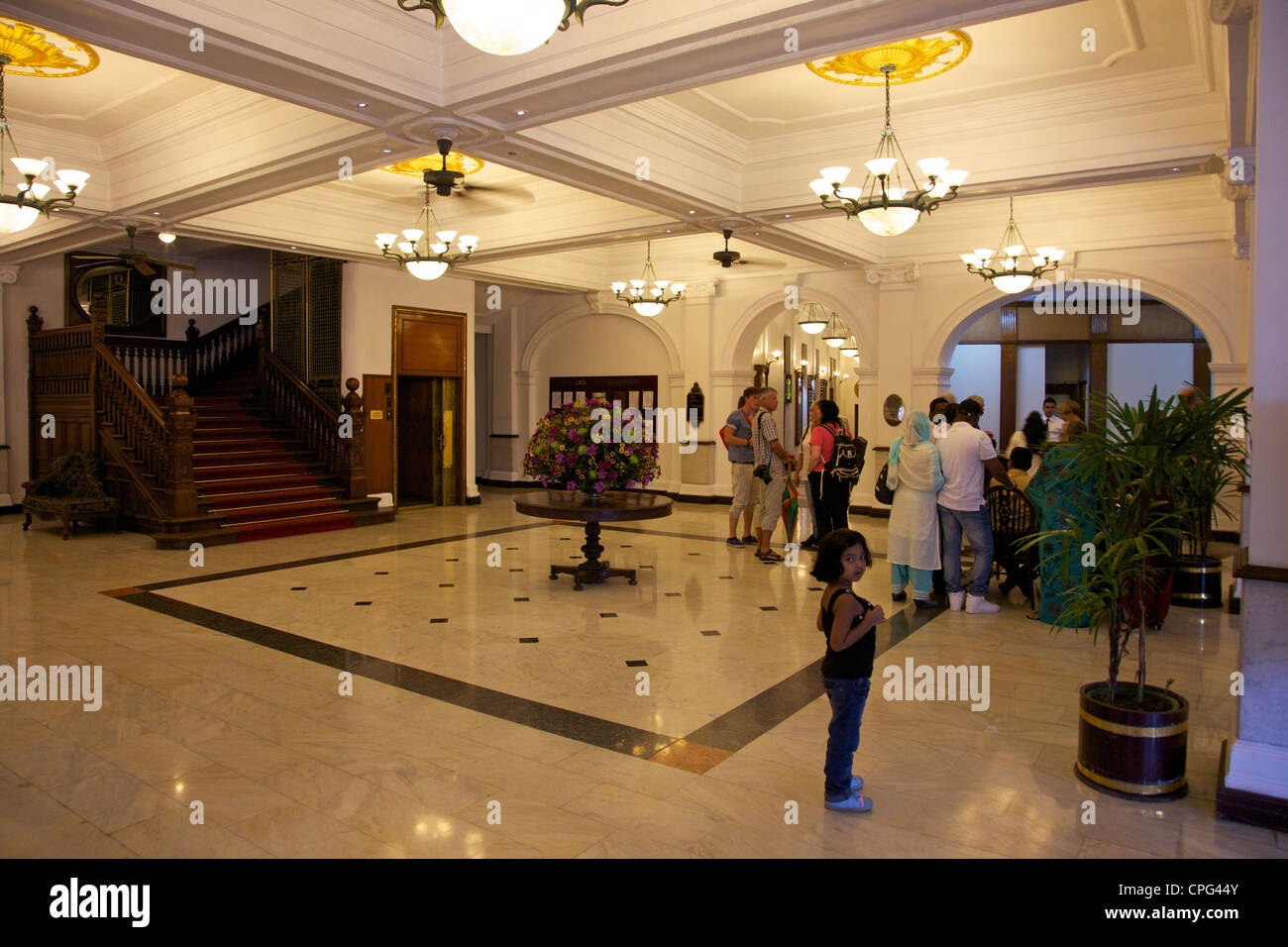 Visitors at reception, Queens Hotel, Kandy, Sri Lanka, Asia - Stock Image