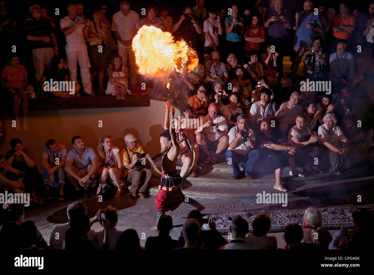 Traditional fire eater walking on hot coals, Cultural Show, Kandy, Sri Lanka, Asia - Stock Image
