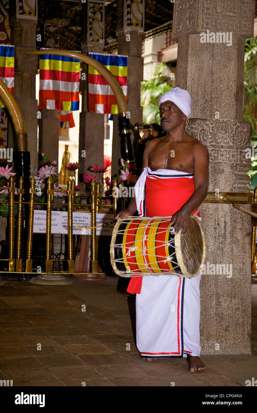 Drummer inside the Tooth Sanctuary, Temple of the Tooth Relic or Sri Dalada Maligawa, Kandy Sri Lanka - Stock Image