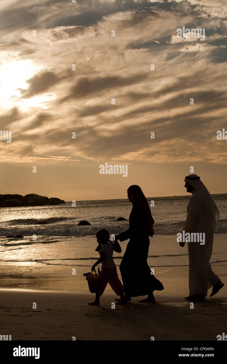 Arab family walking by the beach. - Stock Image