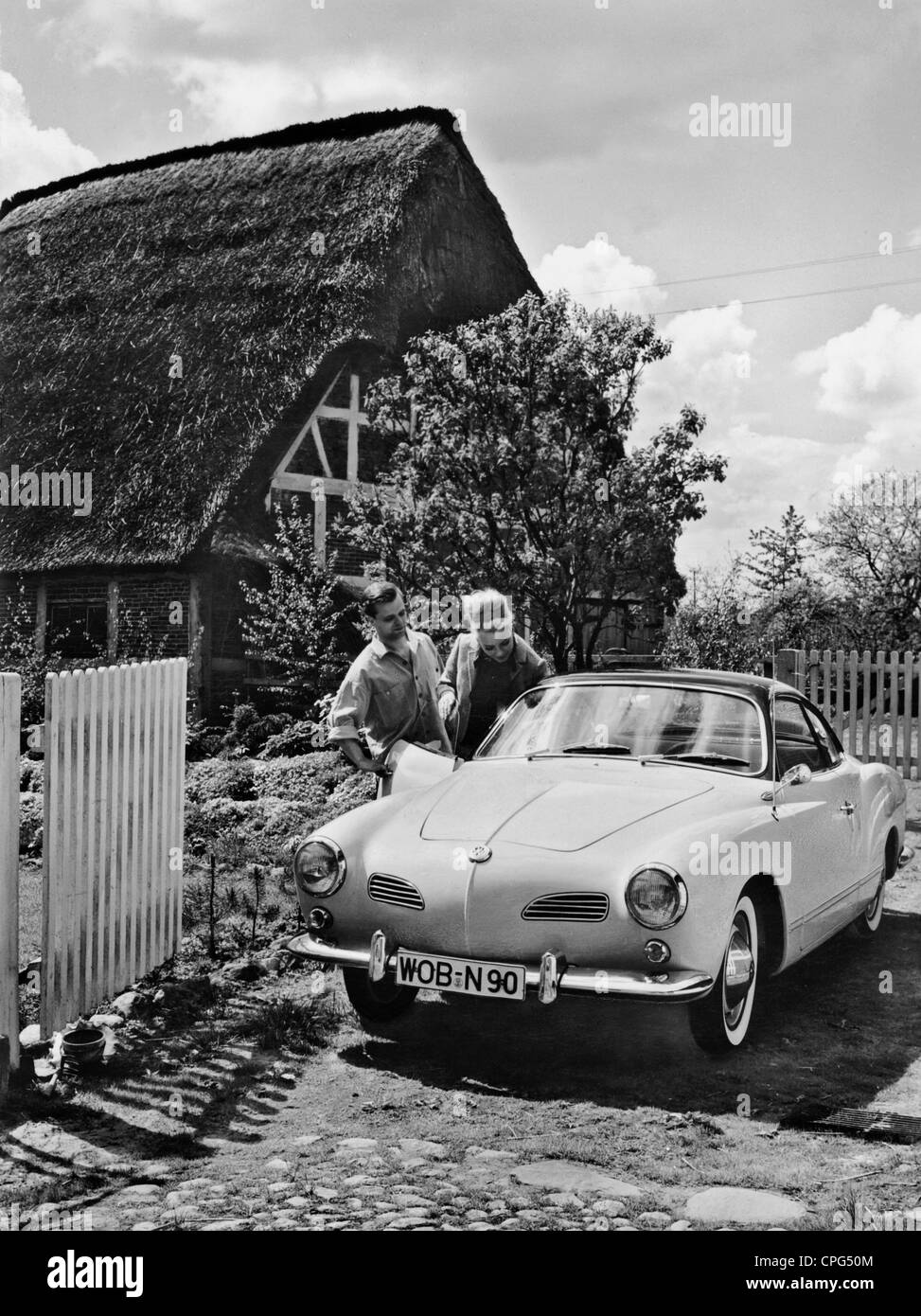 Transport Transportation Car Young Couple Get In A 1950s 50s 20th Century Historic Historical Country Home Countr