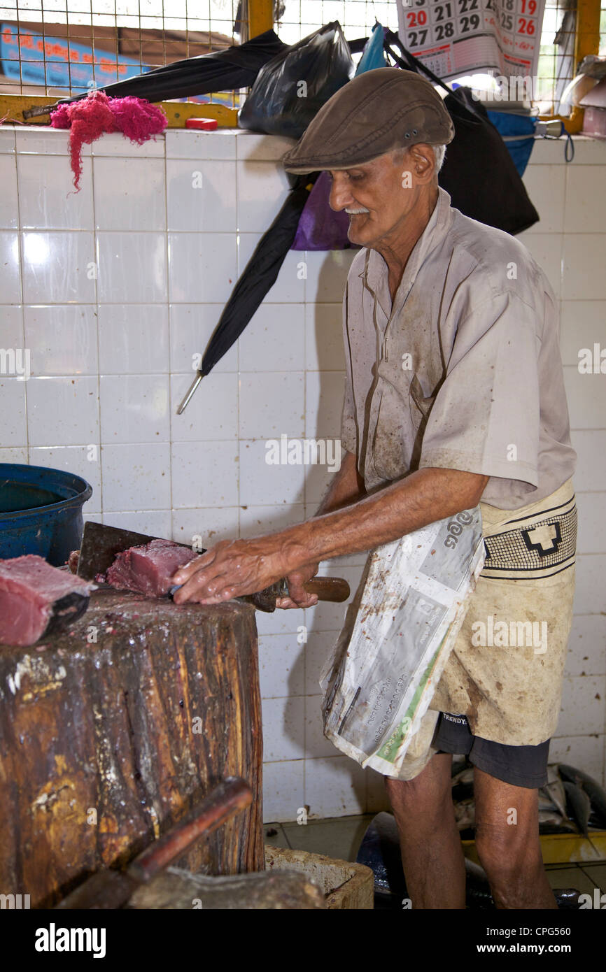 Fishmonger preparing fresh fish for sale at Kandy Market, Sri Lanka, Asia Stock Photo