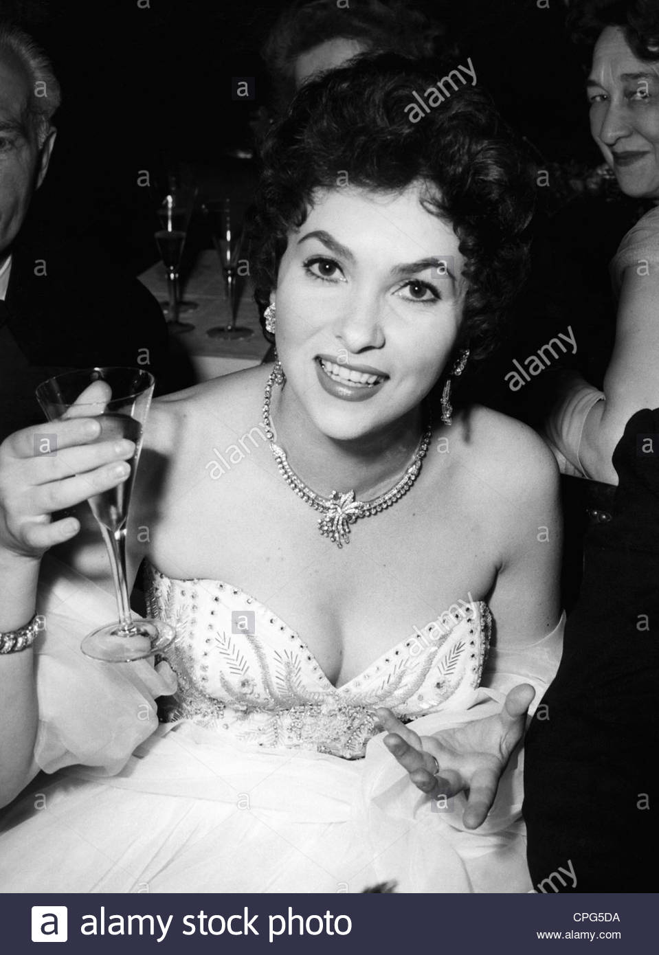 Lollobrigida, Gina, * 4.7.1927, Italian actress, with champagne glass, , Additional-Rights-Clearances-NA Stock Photo