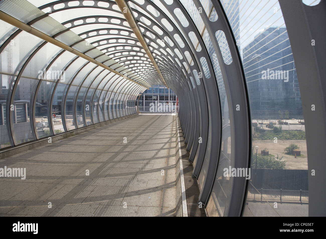 covered foot bridge that connects poplar station to canary wharf - Stock Image