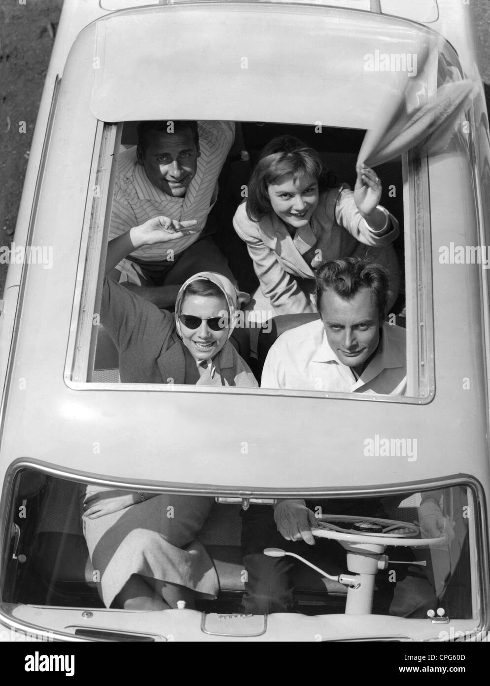 leisure, excurision, young people waving from open convertible top of For Taunus 12M, 1950s, 50s, 20th century, - Stock Image