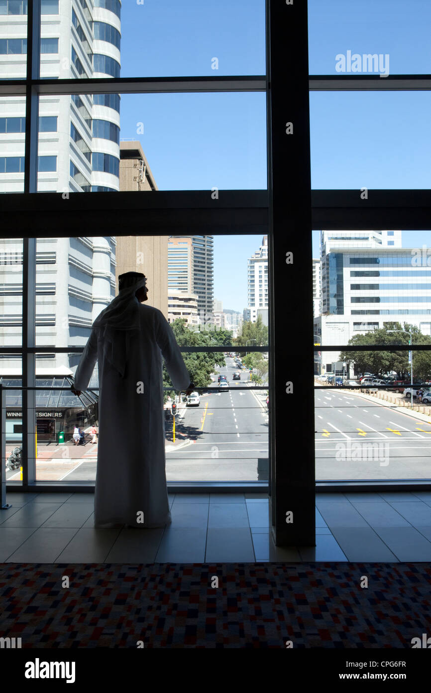 Arab businessman looking out window. Stock Photo