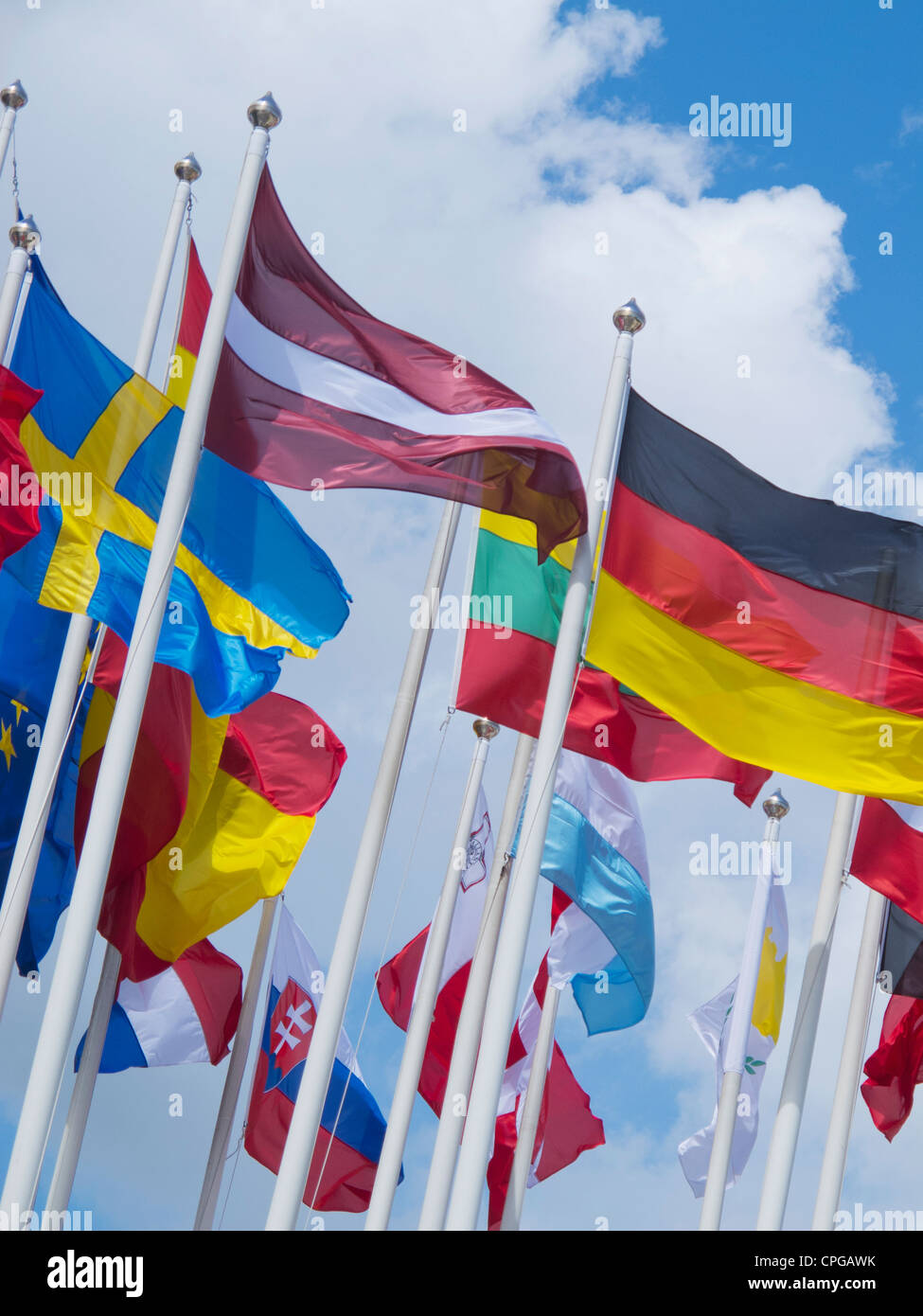 Flags of many nations flying - Stock Image