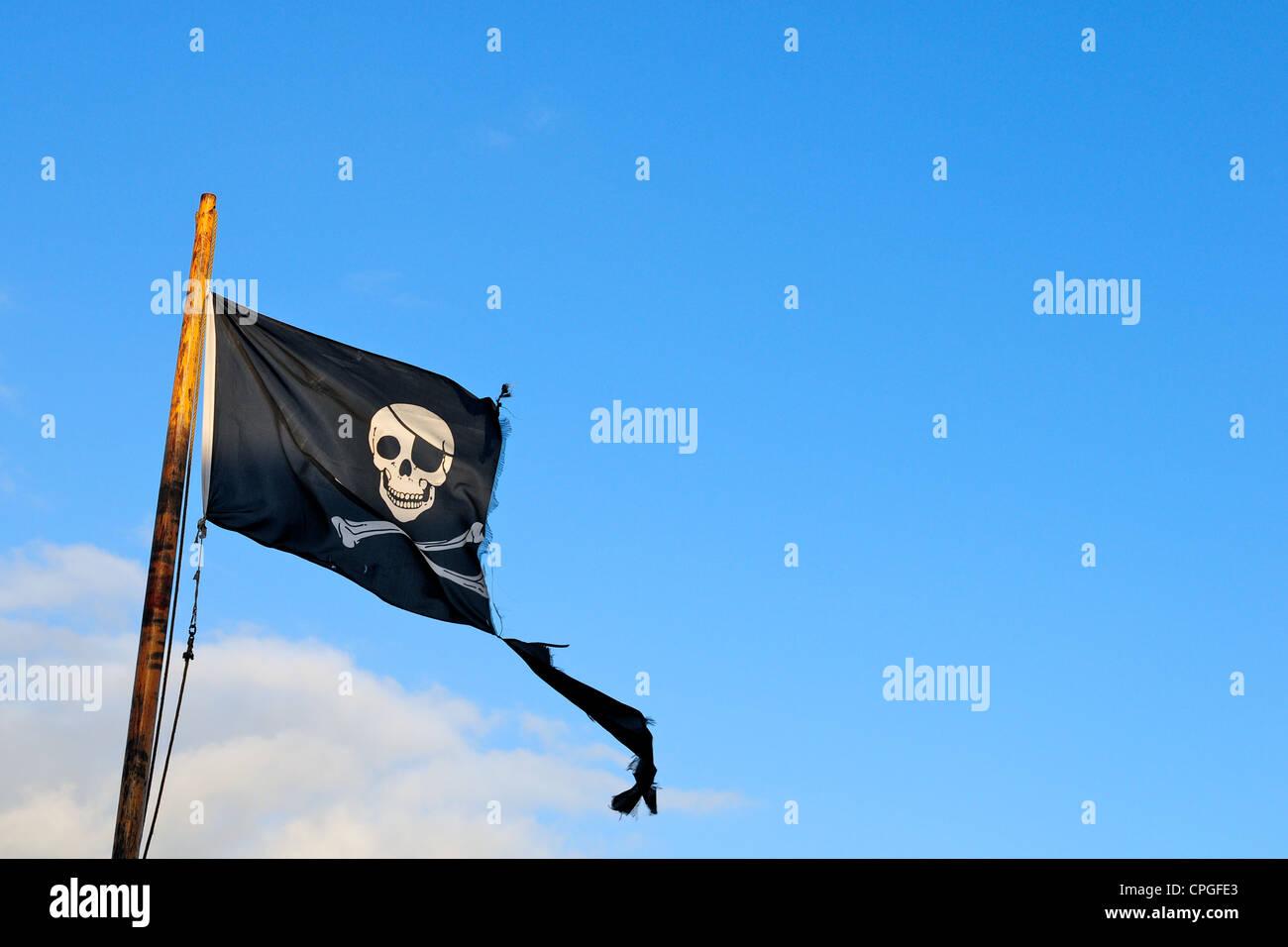 Jolly Roger / skull and crossbones pirate flag - Stock Image