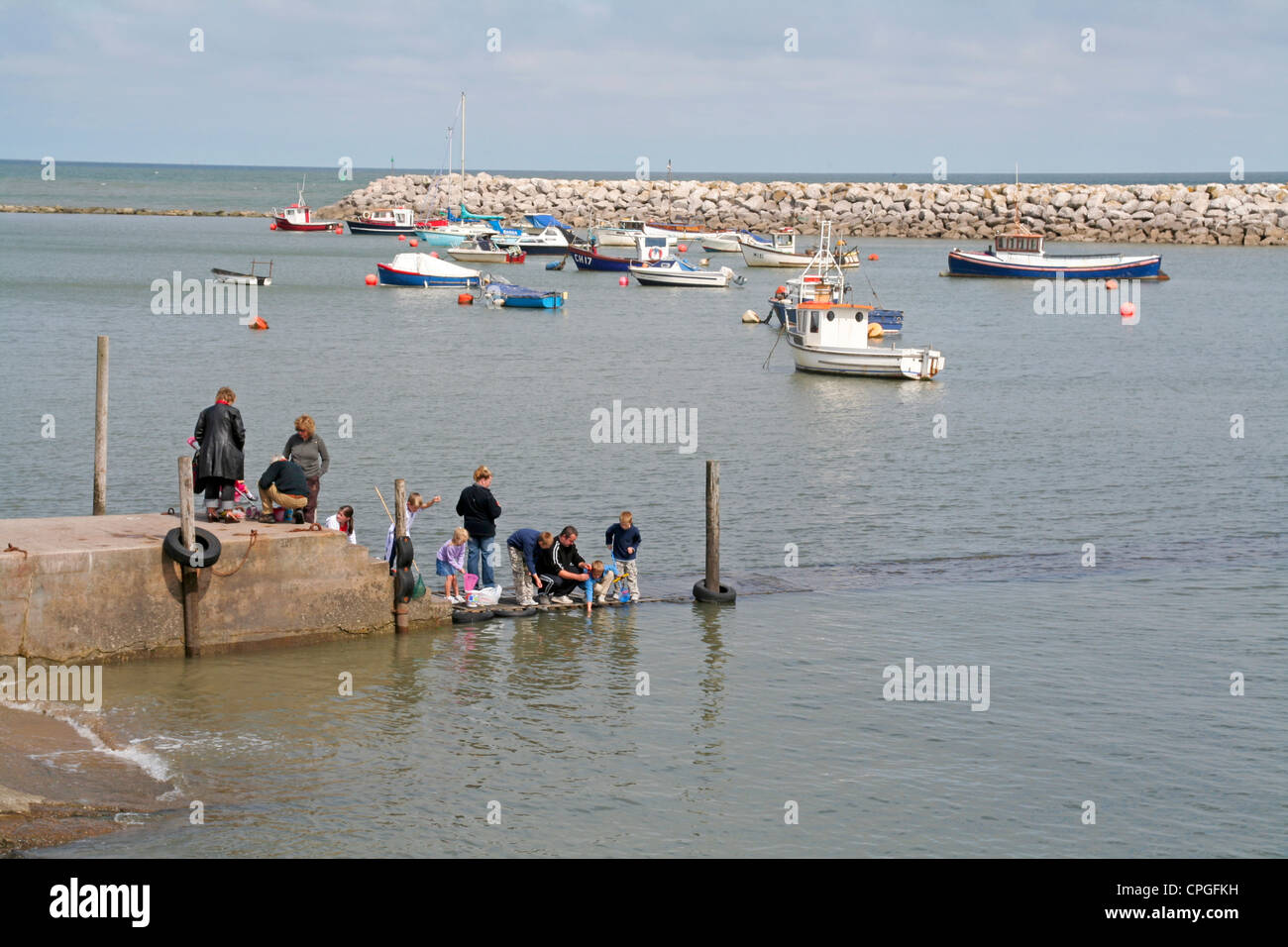 children fishing in harbour Rhos on Sea. Conway Wales - Stock Image