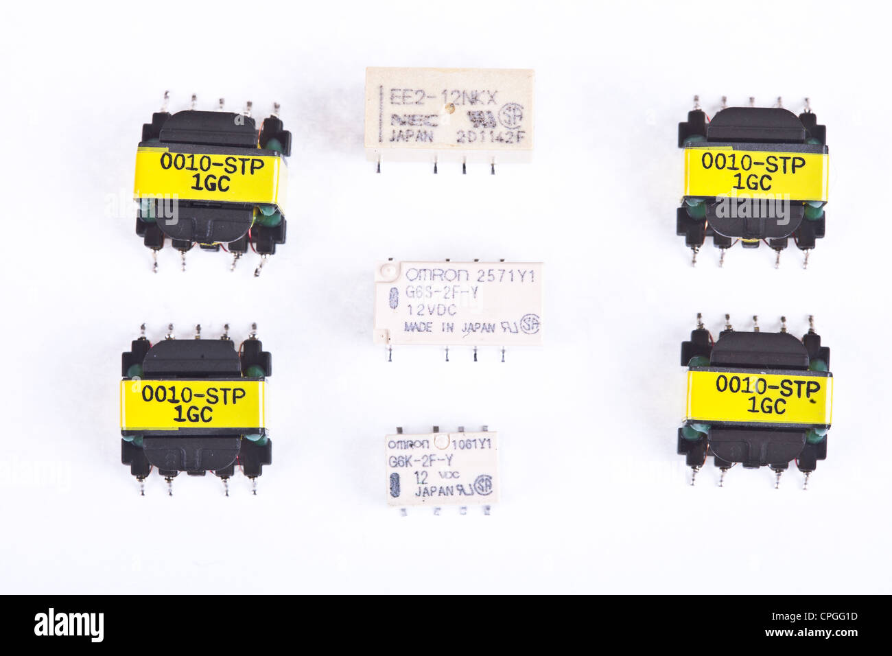 SMT / SMD relays and transformers used to assembly PCB's printed circuit in the electronics industry, electronics - Stock Image