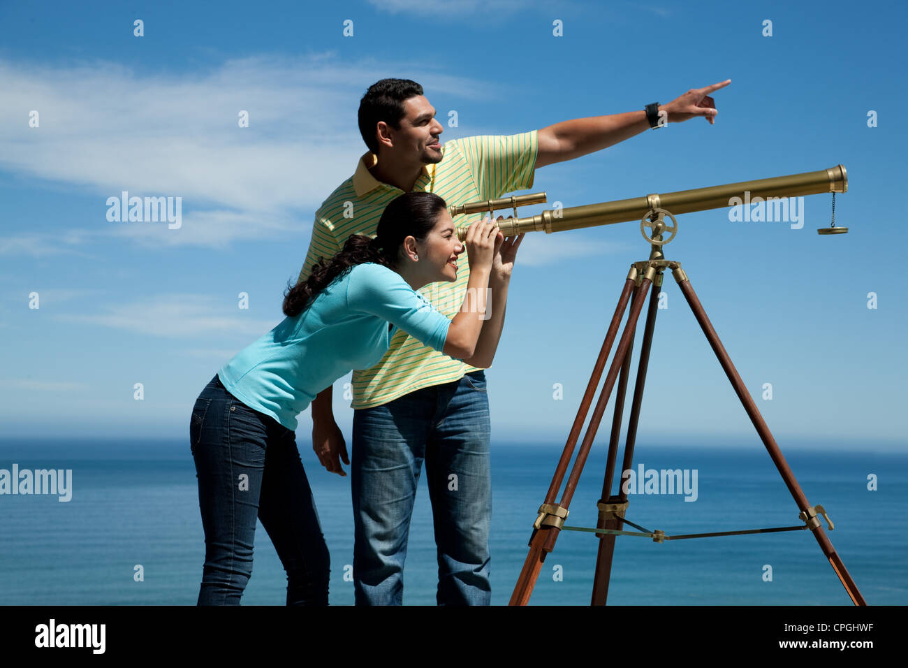 Two People Looking Through Telescope Stock Photos & Two
