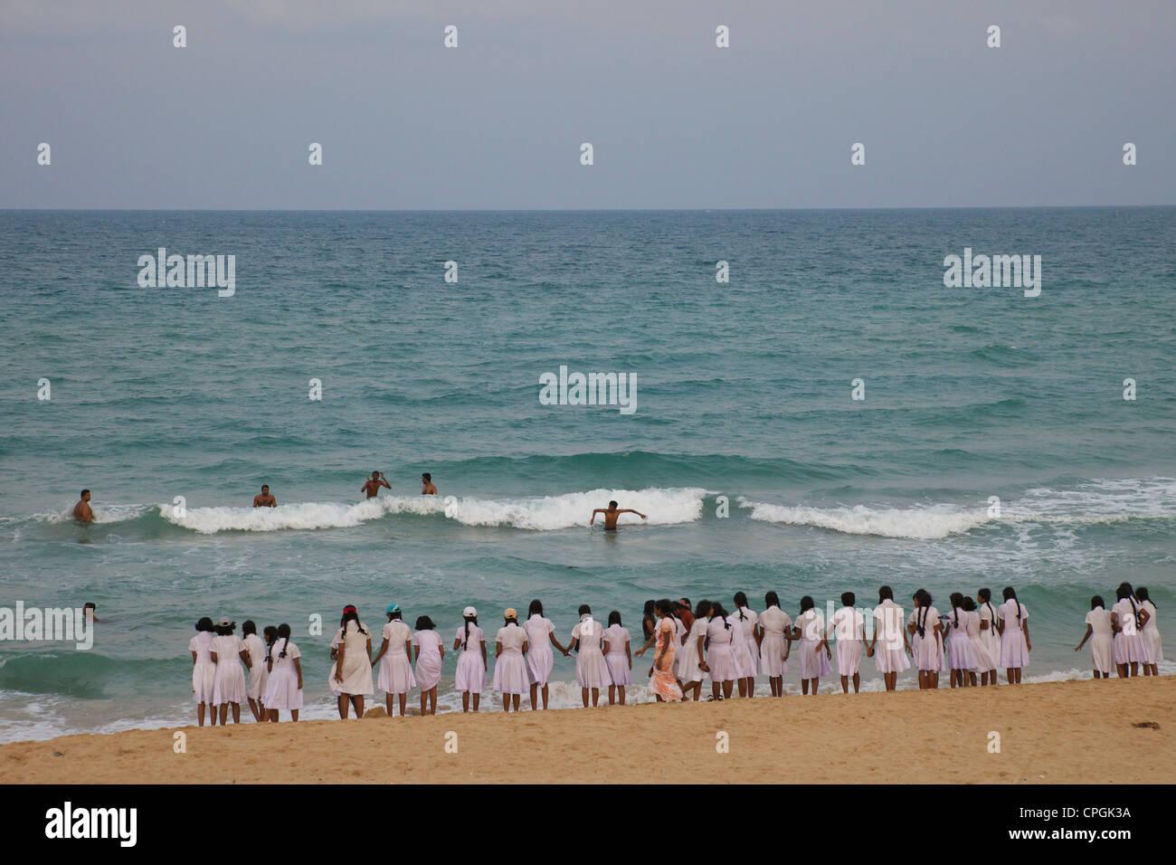 Schoolgirls on the beach, Nilaveli, Trincomalee, Sri Lanka, Asia - Stock Image