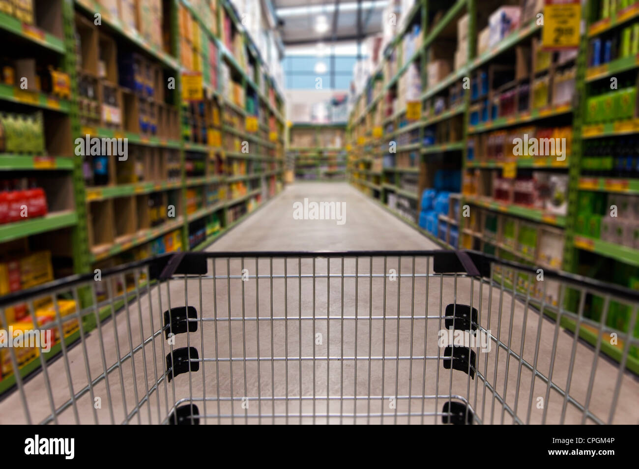 An empty shopping trolley cart in a supermarket. - Stock Image