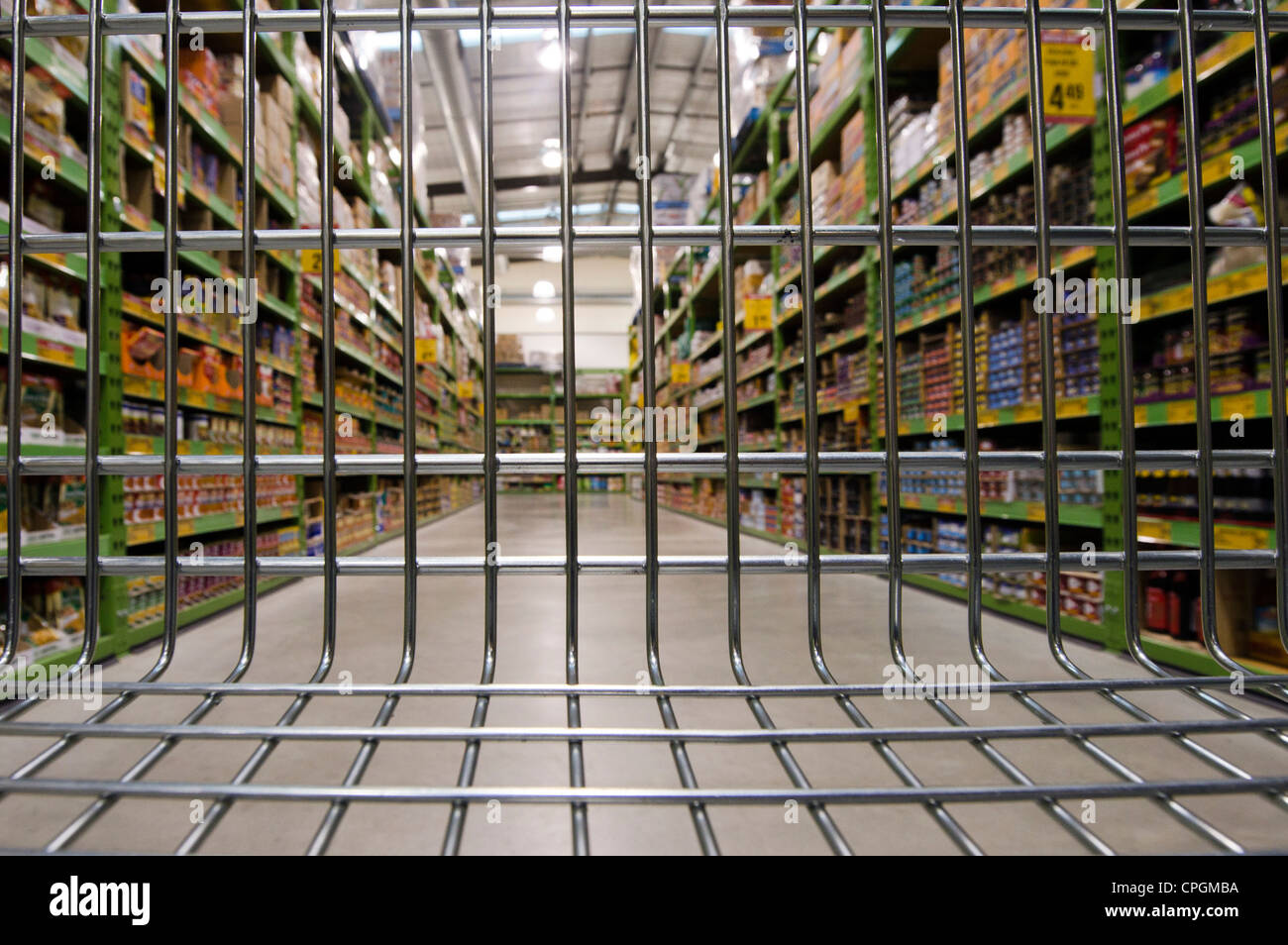 An empty shopping trolley cart in a supermarket. Stock Photo